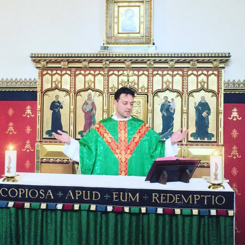 fr chalres celebrating mass